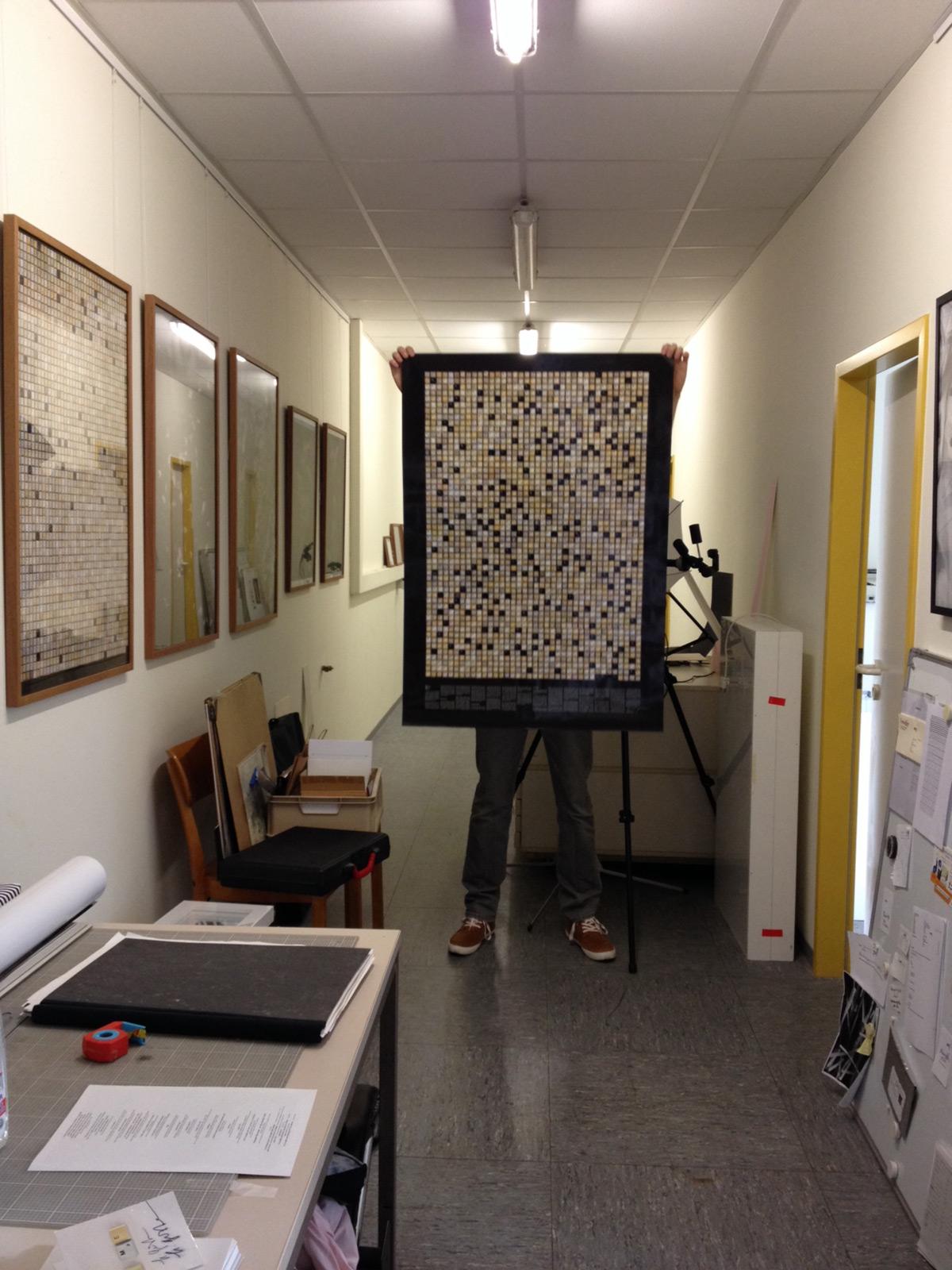 Holding 2014 Typographic Wall Calendar in Studio